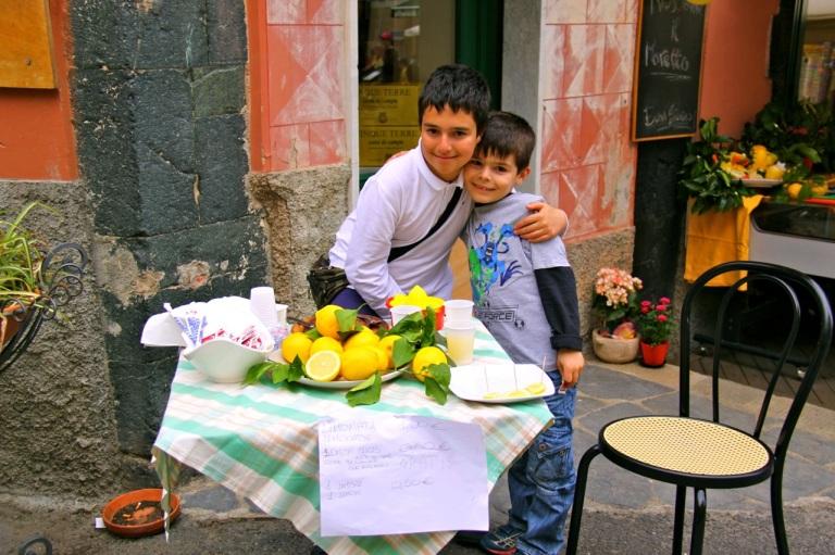 Boys selling lemons. Photo Vivie Bjørnstad